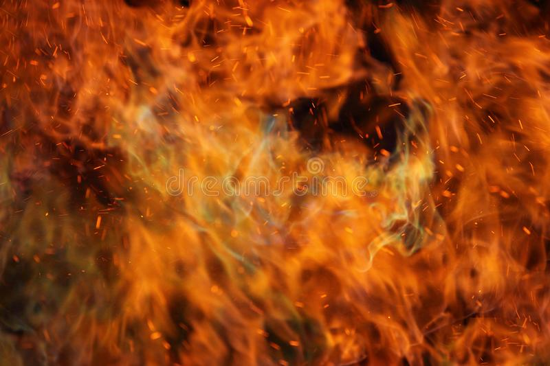 Abstract fire flames in dark area. Abstract fire flames in dark background stock photo