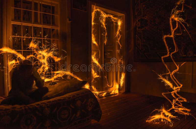 Abstract fireworks flame freezelight on window. Apartment building on Fire at Night time. Fire concept. Azerbaijan royalty free stock images