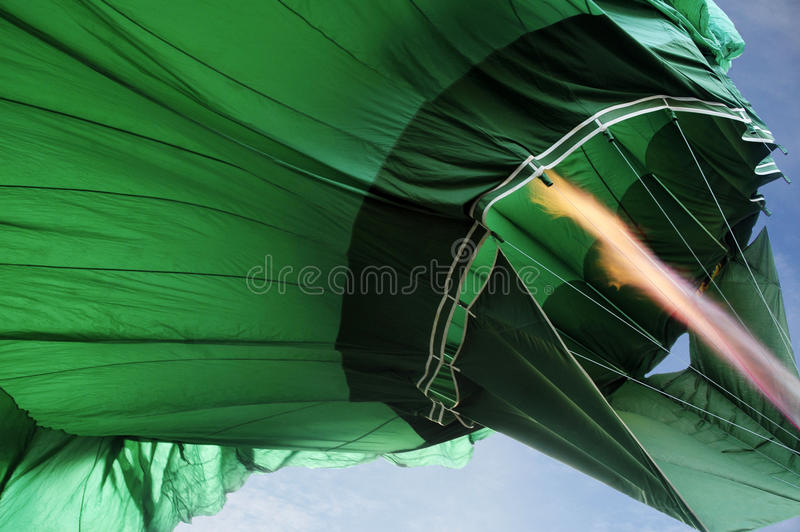 Abstract - Flame from Green Hot Air Balloon. Flame from green Hot Air Balloon with blue sky on the background stock image