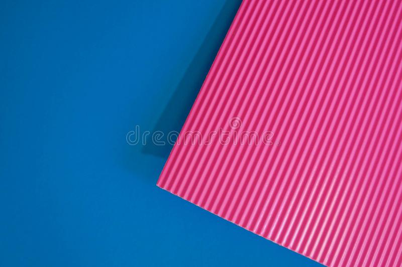 Abstract flat lay background with color crepe paper sheets. Pink and blue royalty free stock image