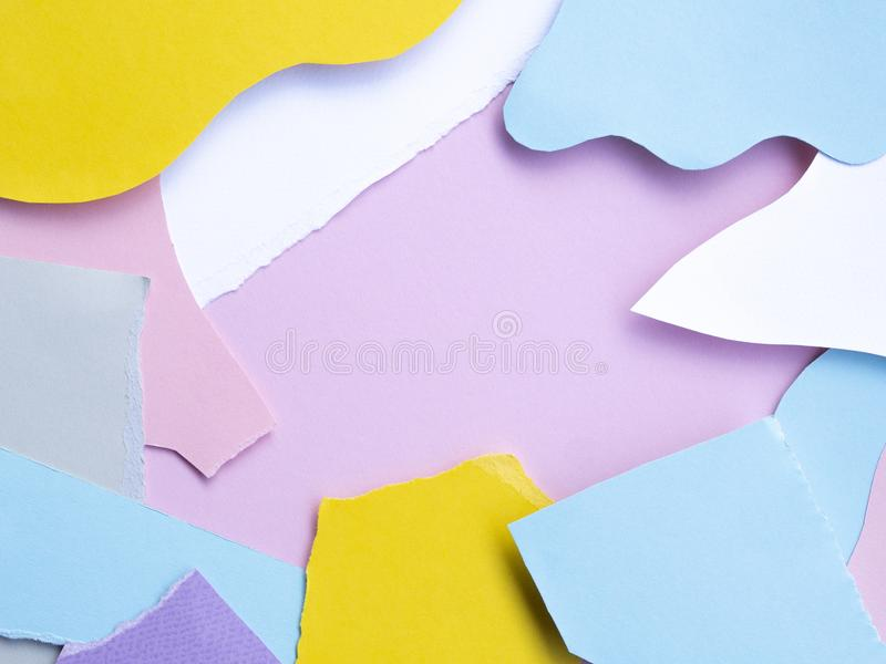 Abstract flat lay background torn and cutted colorful Paper Scraps royalty free stock photography