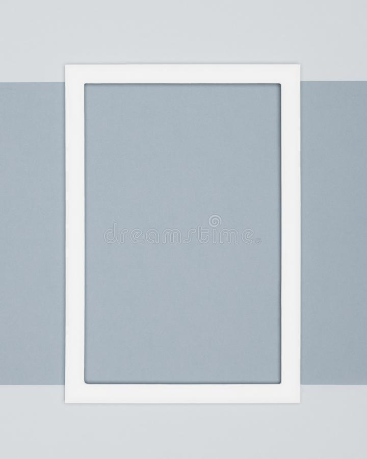 Abstract flat lay pale grey colored paper texture minimalism background. Minimal template with empty picture frame. Abstract flat lay pale grey colored paper royalty free stock photo