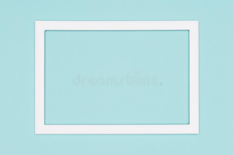 Abstract flat lay pastel blue colored paper texture minimalism background. Template with empty picture frame mock up. Abstract flat lay pastel blue colored royalty free stock photos