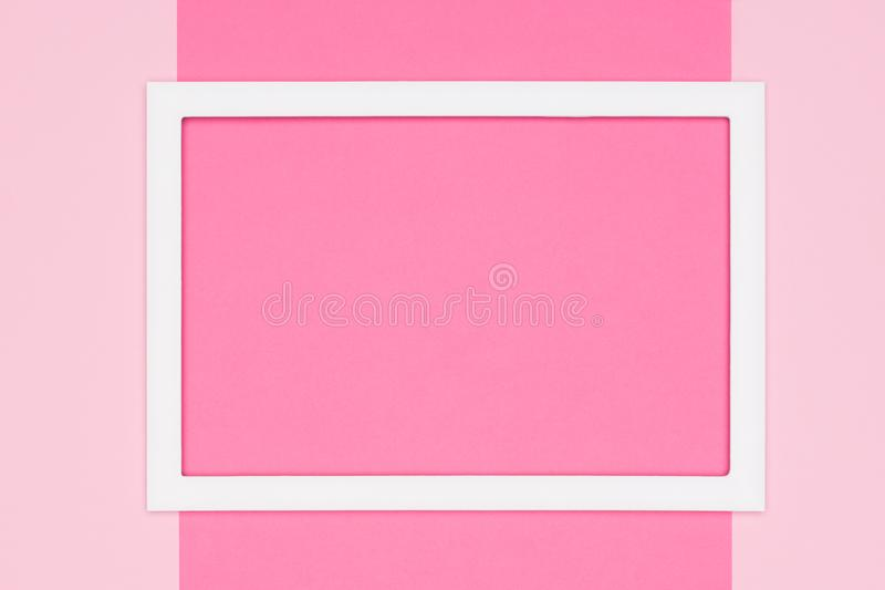 Abstract flat lay pastel pink colored paper texture minimalism background. Minimal template with empty picture frame. Abstract flat lay pastel pink colored royalty free stock image