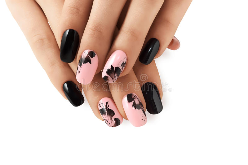 Abstract floral pattern on nails. Abstract floral pattern on pink nails black royalty free stock photos