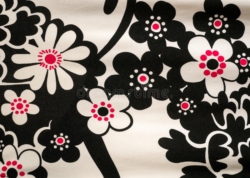 Abstract Flower Fabric Textile Pattern. A Black, white and red fabric with a flower-like pattern on it stock images