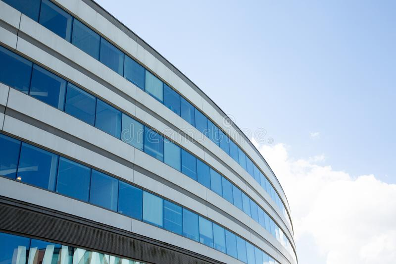 Abstract fragment of modern architecture round blue tone royalty free stock image