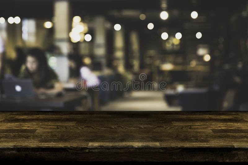 Abstract, freelancer working on laptop in cafe with a cup of coffee. stock image