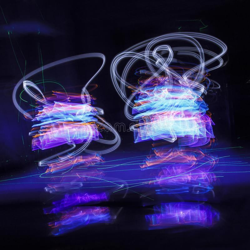 Abstract freezelight curves. light painting. Abstract freezelight curves. Abstract color shape on black made with light painting or light drawing royalty free stock images
