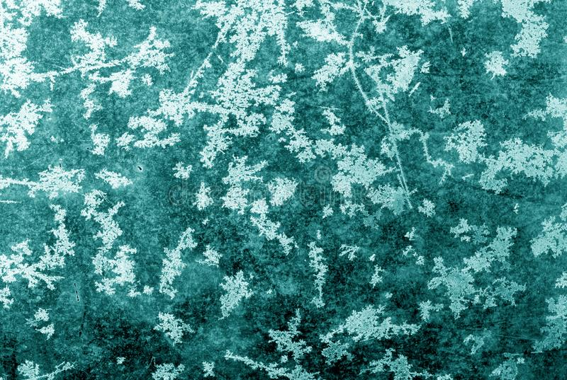 Abstract frost pattern on glass in cyan tone. Abstract background and texture for design, blue, green, color, window, nature, season, winter, snow, weather stock image