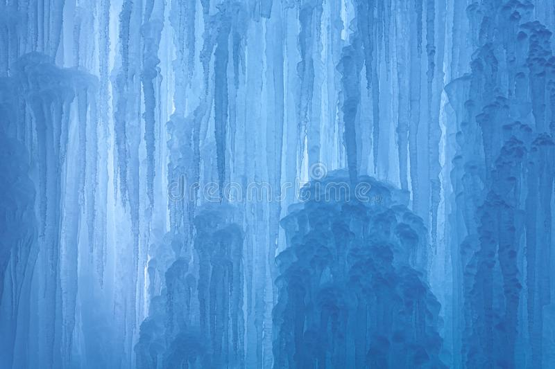 An abstract frozen waterfall with blue and white ice and beautiful details in winter stock image