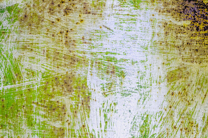 Abstract full color background for design. Classic color grunge wall texture. Peeling paint on the rusty metal surface stock photo