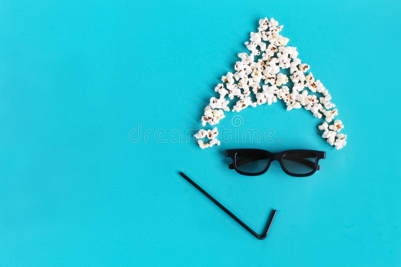 Abstract fun image of viewer, 3D glasses, popcorn. Cinema time on blue paper background. Concept cinema movie and entertainment. royalty free stock images