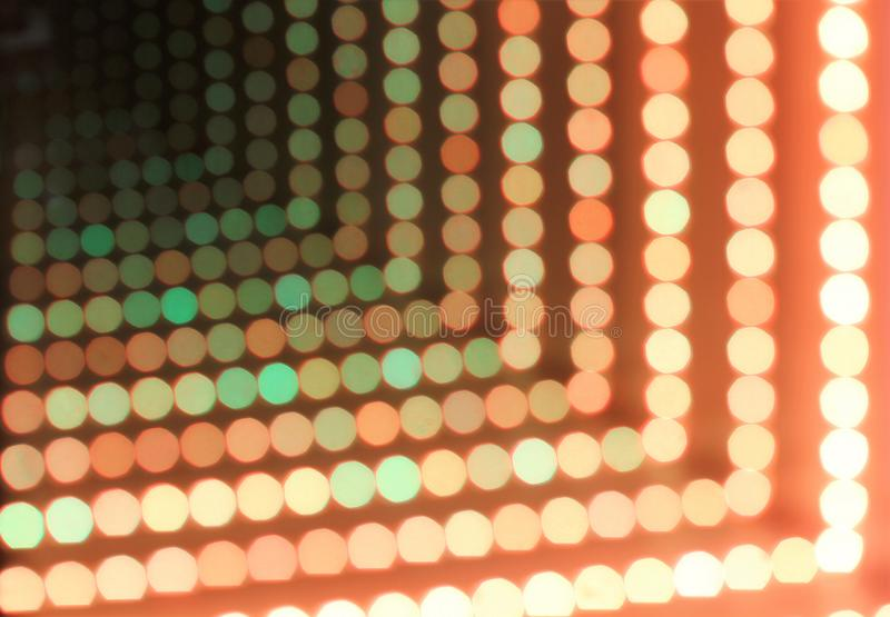 Abstract background of glowing dotted neon lights, perspective view royalty free stock photos