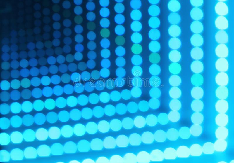 Abstract background of glowing dotted neon lights, perspective view royalty free stock image