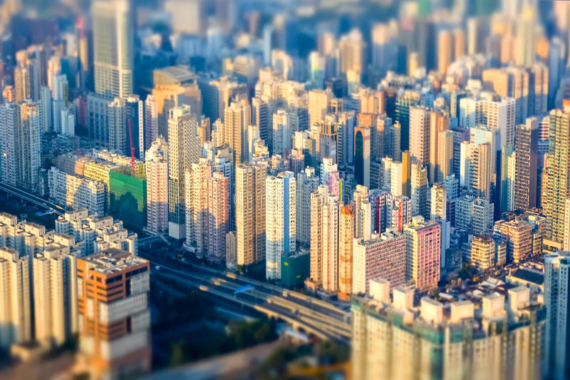 Abstract futuristic cityscape. Hong Kong. Tilt shift effect. Abstract futuristic cityscape with modern skyscrapers. Hong Kong aerial view evening panorama. Tilt royalty free stock images