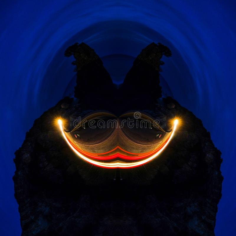 Abstract futuristic face smile graphic artwork ober deep blue background, wallpaper fantasy dark face with eyes and smile royalty free stock photography