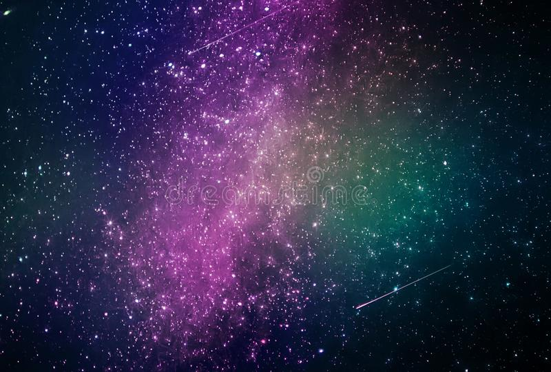 Abstract galaxy background with stars and planets with colorful galaxy motifs of universe night light space. With the best quality and resolution royalty free stock photo