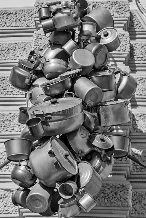 Abstract garland from old metal ware. Abstract composition from old metal household utensils or ware closeup located in one heap or in a garland of black-and stock photos