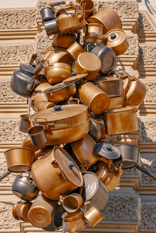 Abstract garland from old metal ware. Abstract composition from old metal household utensils or ware closeup located in one heap or in a garland of vintage color royalty free stock images