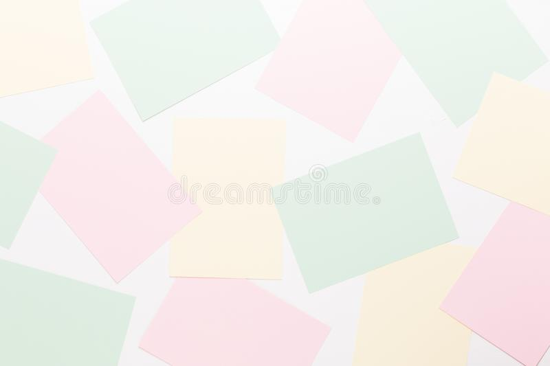 Abstract geometric background in light pastel tones from sheets of thick pale past paper stock images