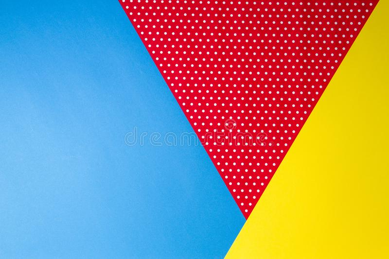 Abstract geometric blue, yellow and red polka dot paper background. royalty free stock photos