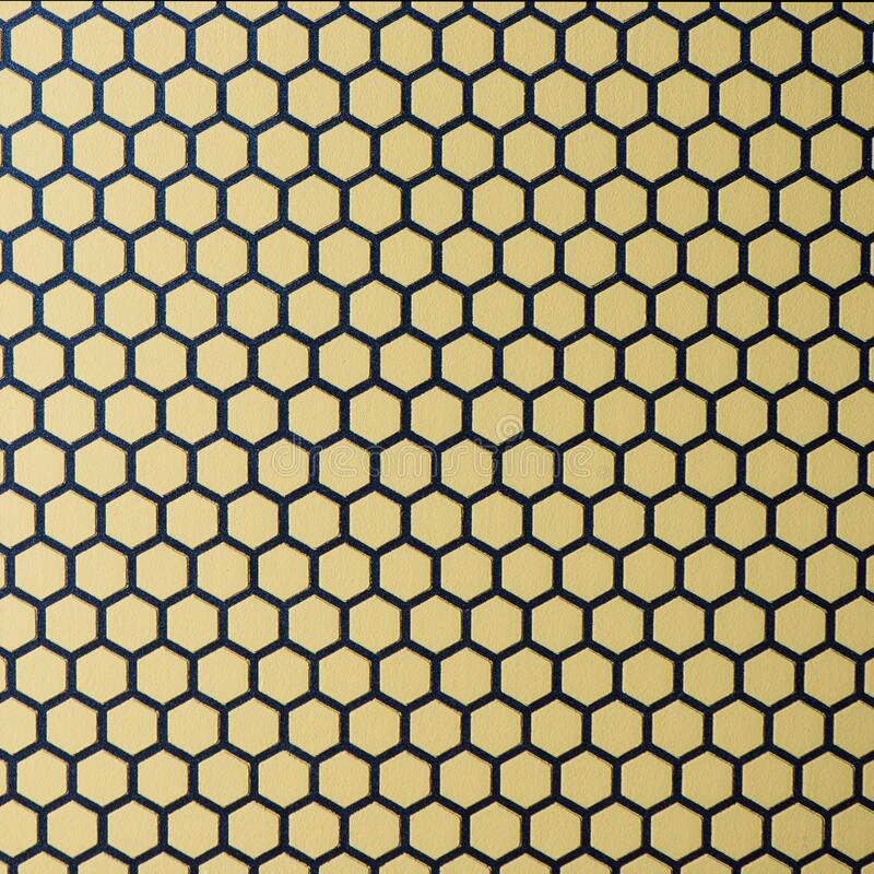 Honeycomb patterns over cement texture stock image