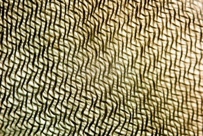 Abstract geometric illusory background of tissue threads macro. Photo royalty free stock photo