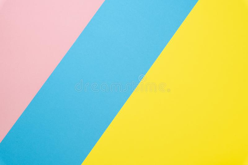 Abstract geometric paper background. Blue, pink and yellow trend colors. Flat lay.Top view royalty free stock photos