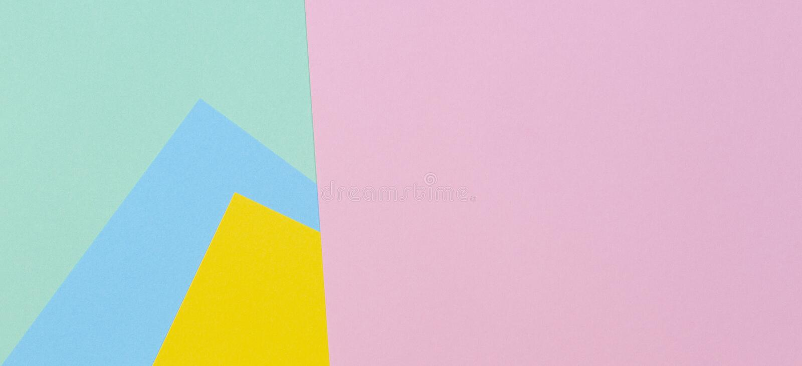 Abstract geometric paper texture background with trendy colors pastel pink, yellow, light blue and green color royalty free stock images