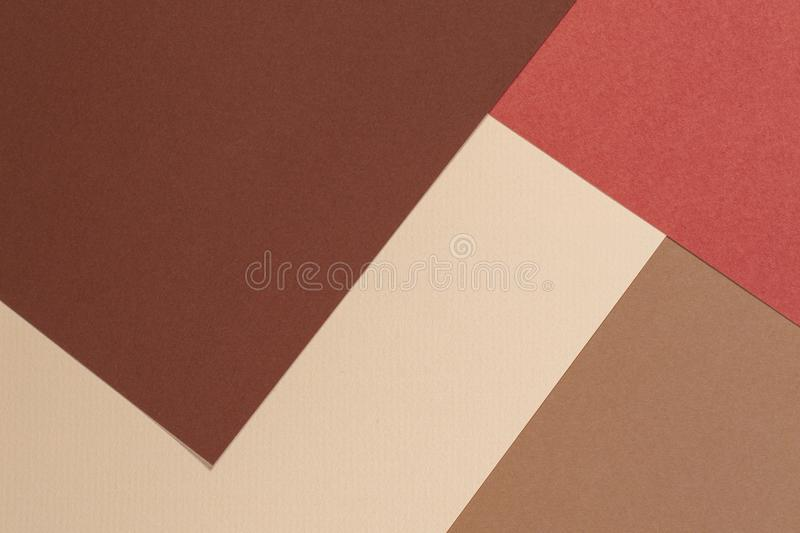 Abstract geometric paper texture cardboard background. Beige, brown yellow pastel trendy colors royalty free stock photography
