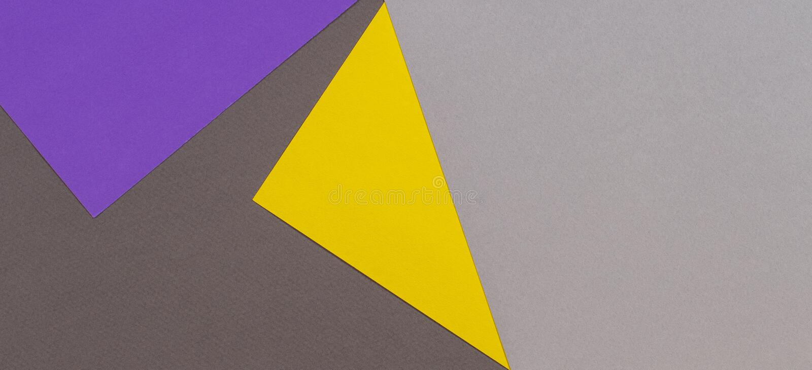 Abstract geometric paper texture cardboard background. Top view of purple violet yellow gray trendy colors tones royalty free stock images