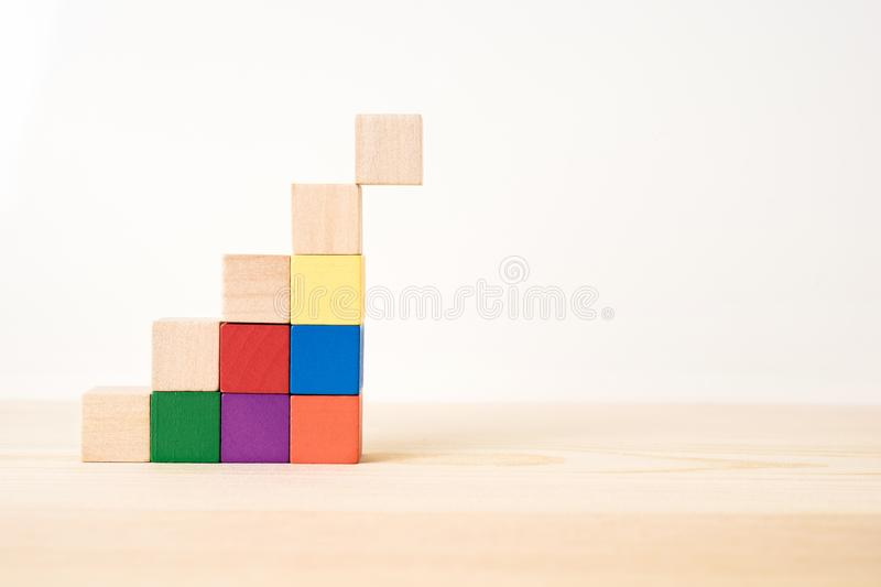 Abstract geometric real wooden colored cube on wooden floor background and it`s not 3D render. It`s the symbol of support, teamw stock photography