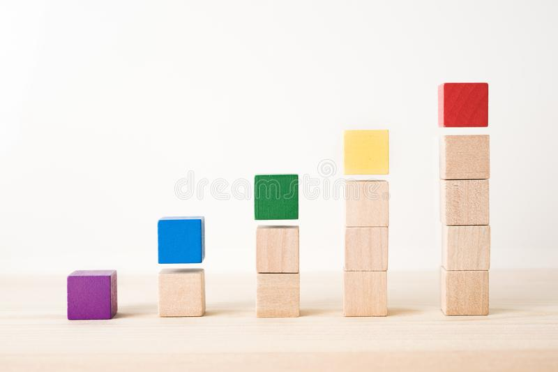 Abstract geometric real wooden colored cube on wooden floor background and it`s not 3D render. It`s the symbol of support, teamw stock photos