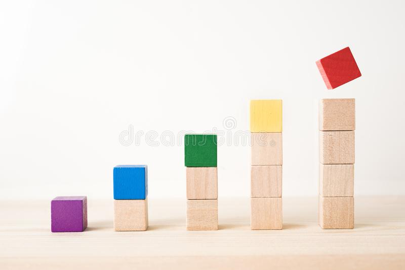 Abstract geometric real wooden colored cube on wooden floor background and it`s not 3D render. It`s the symbol of support, teamw stock photo