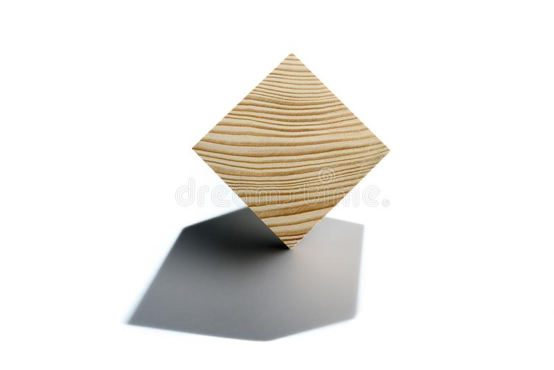 Concept of bussines balancing. Wooden cube on corner. Abstract geometric real wooden cube isolated on white background with real shadow and it`s not 3D render stock photos