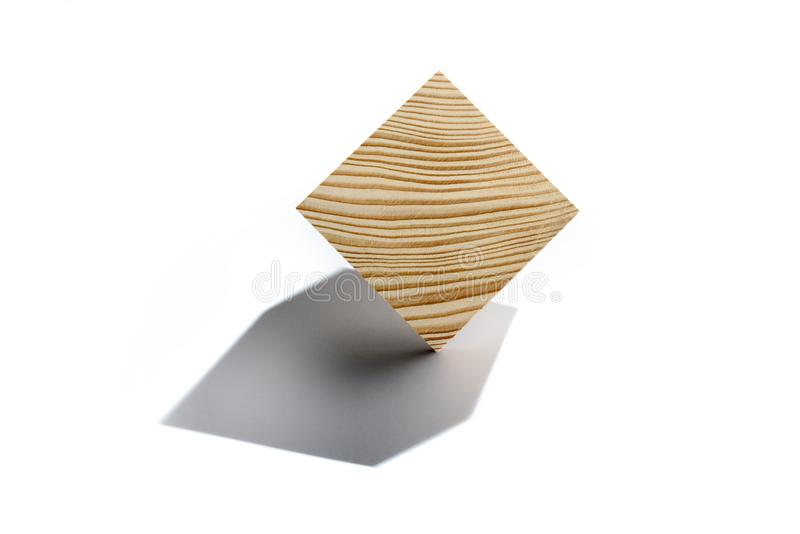 Concept of bussines balancing. Wooden cube on corner. Abstract geometric real wooden cube isolated on white background with real shadow and it`s not 3D render stock images