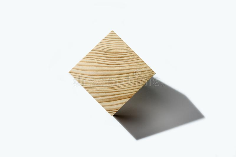 Concept of bussines balancing. Wooden cube on corner. Abstract geometric real wooden cube isolated on white background with real shadow and it`s not 3D render royalty free stock image