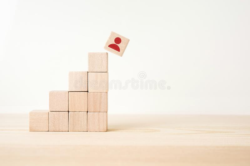 Abstract geometric real wooden cube pyramid on white floor background and it`s not 3D render. It`s the symbol of make a mistake, stock image