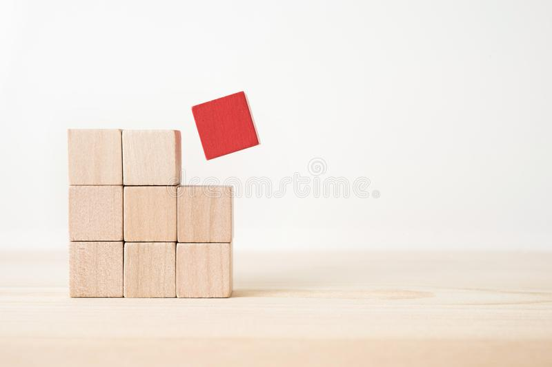 Abstract geometric real wooden cube with surreal layout on white floor background and it`s not 3D render. It`s the symbol of lea stock photos