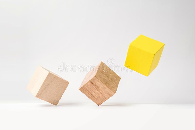Abstract geometric real wooden cube with surreal layout on white floor background, the symbol of leadership, teamwork and growth stock photo