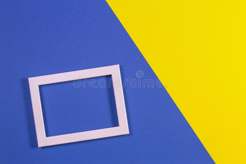 Abstract geometric shapes colored paper texture background with empty picture frame stock photos