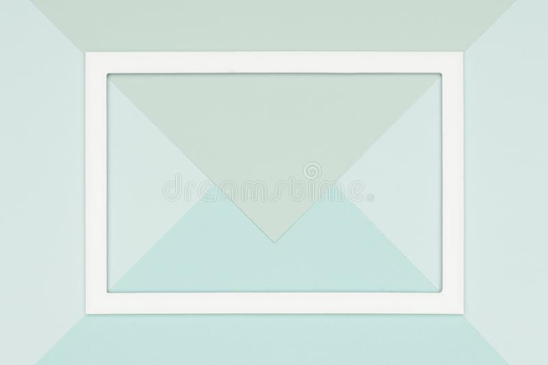 Abstract geometrical flat lay pale pastel blue and green colored paper background. Minimalism, geometry and symmetry template. Abstract geometrical flat lay stock photo