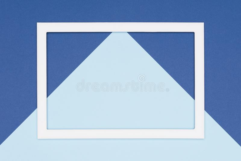 Abstract geometrical flat lay pastel blue colored paper background. Minimalism, geometry and symmetry template with empty frame. Abstract geometrical flat lay stock photos