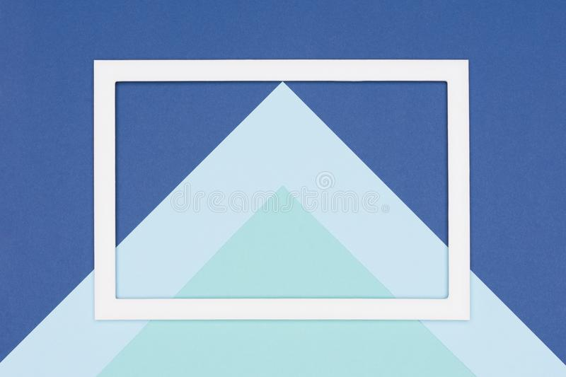 Abstract geometrical flat lay pastel blue and turquoise colored paper background. Minimalism, geometry and symmetry template. Abstract geometrical flat lay stock image