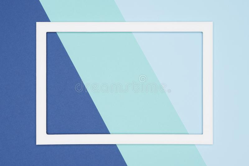 Abstract geometrical flat lay pastel blue and turquoise colored paper background. Minimalism template with empty picture frame. stock images