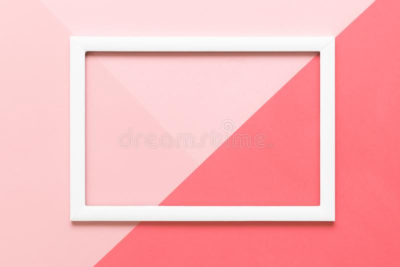Abstract geometrical living coral and pastel pink paper flat lay background. Minimalism, geometry and symmetry template. Abstract geometrical living coral and stock photography