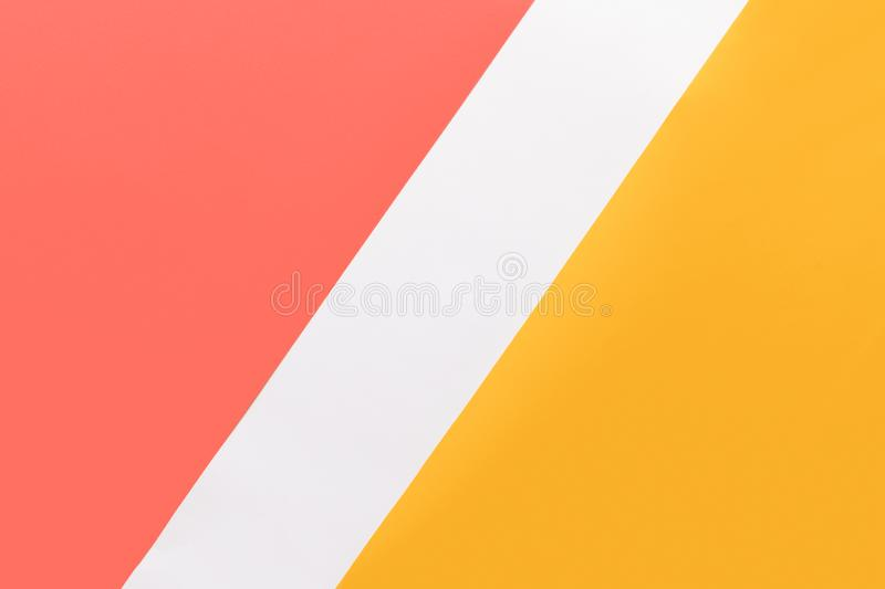 Abstract geometrical living coral, yellow and white paper flat lay background. Minimal, geometry and symmetry paper texture. Abstract geometrical living coral royalty free stock photos