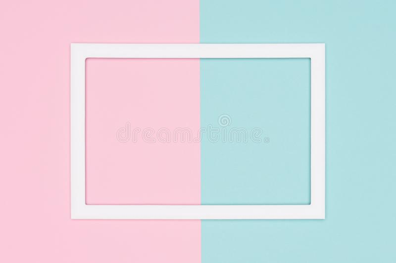Abstract geometrical pastel blue and pink colored paper flat lay background. Minimalism template with empty picture frame. Abstract geometrical pastel blue and stock photography