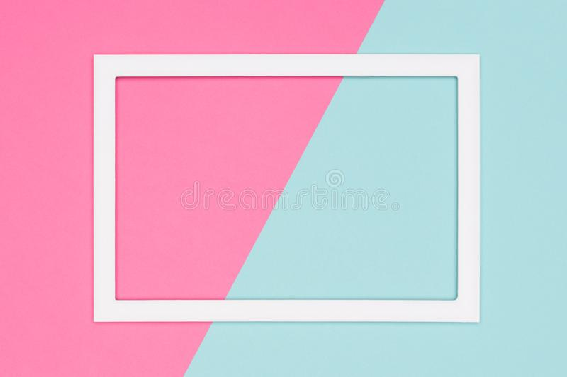 Abstract geometrical pastel blue and pink colored paper flat lay background. Minimalism template with empty picture frame. Abstract geometrical pastel blue and royalty free stock photos
